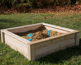 Open cedar sandbox or planter box.