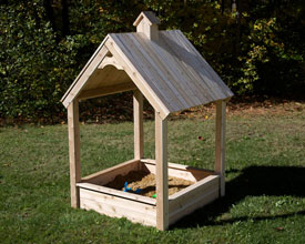 Cedar Sandbox with wooden roof.
