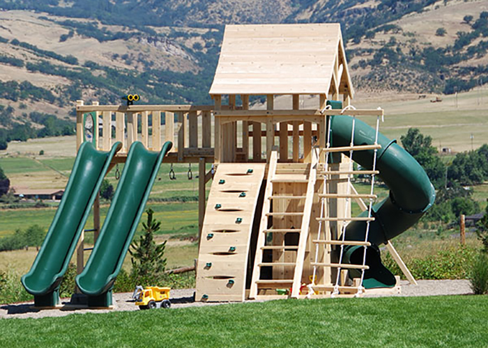 Cedar swing set with two green scoop slides in Ashland, OR.