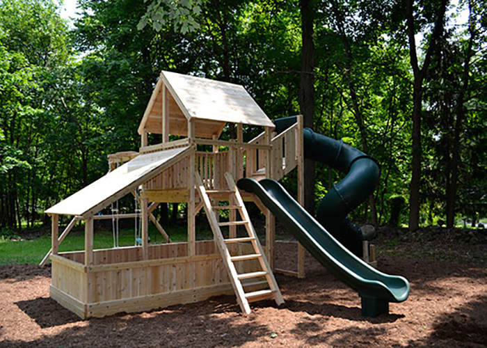 Cedar swing set with lower clubhouse in New City, NY.