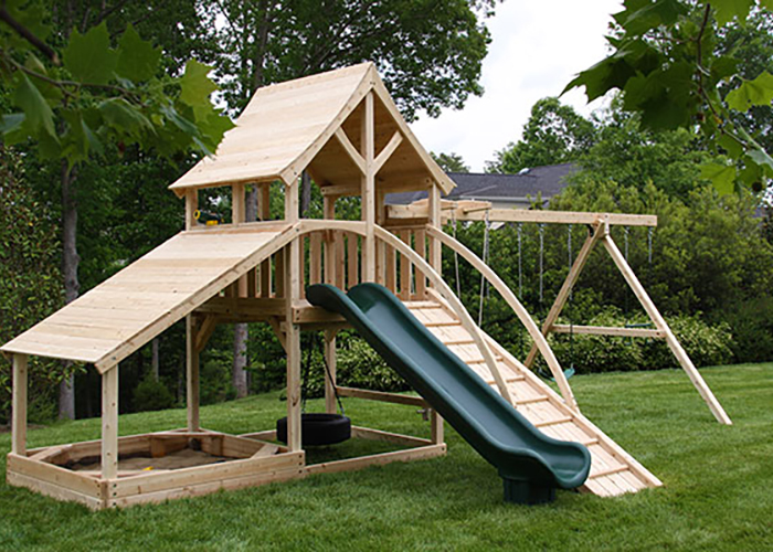Cedar swing set with arched roof and large sandbox in Keswick, VA.