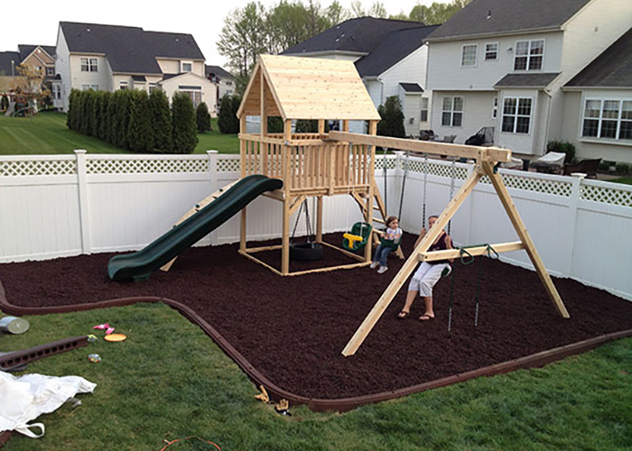 Cedar swing set with rubber mulch underneath in Bordentown, NJ.