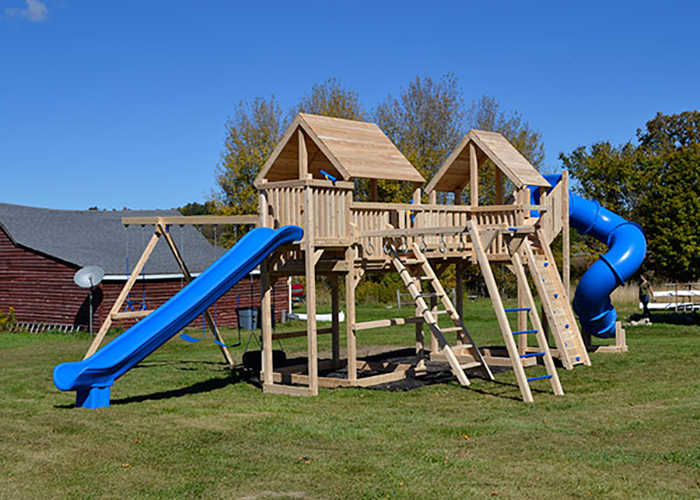Two swing sets with tower connected with a bridge in Sharon Springs, NY.