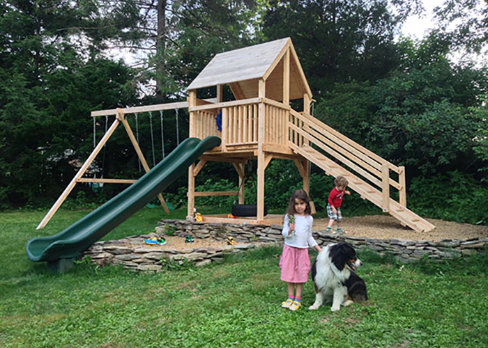 Cedar swing set with long scoop slide in Durham, NH.