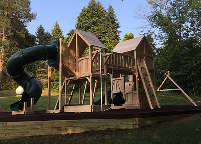 Double cedar swing set with loads of options in Athol, MA