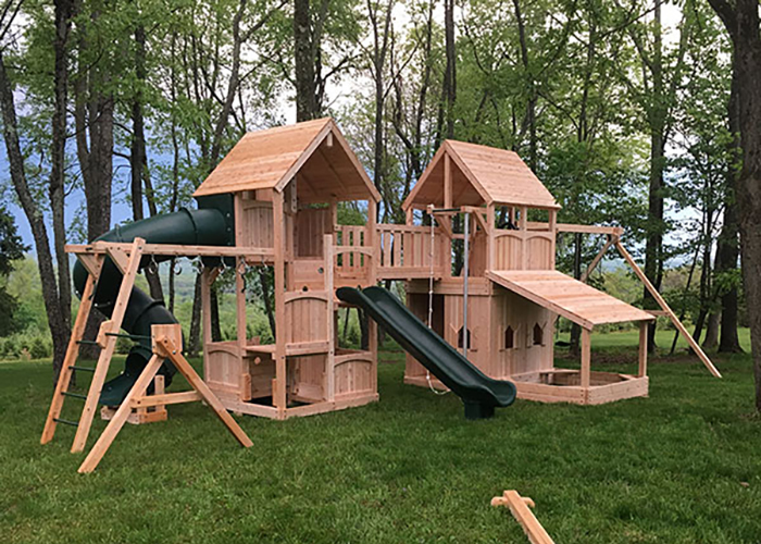 Triumph Play Systems custom double fort swing set in Fredon, NJ.