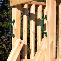 Plastic playset handles attacted to a cedar swing set.