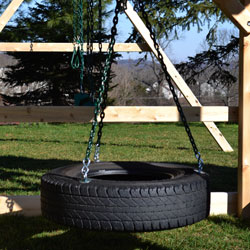 360 degree tire swing under a swing set fort.