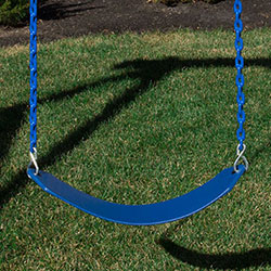 Green belt swing with Vinyl Dipped Chains attacted to a cedar swing set.