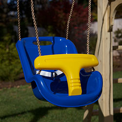 Green and yellow plastic infant swing with rope.