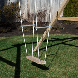 Cedar skate board swing with rope and aluminum handles.
