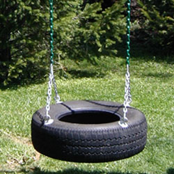 Tire swing with Vinyl Dipped Chains attacted to a cedar swing set beam.