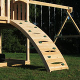 Arched wooden swing set rock wall with green rock holds.