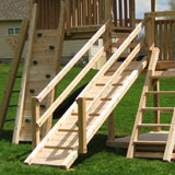 Wooden swing set ramp with post and hand rails.