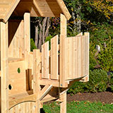 Wooden swing set crow's nest with arched front panel.