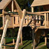 Wooden swing set monkey bars with steel hand hold rings.