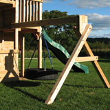 Wooden swing set arm with a 360 degree tire swing.