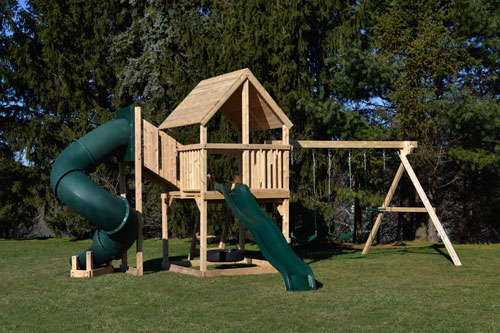 Cedar swing sets with green tube slide, green wave slide and wood woof.