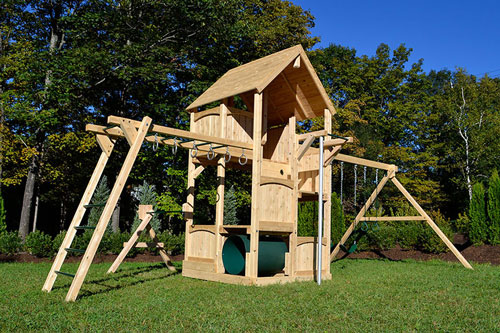 Cedar swing set with five levels, wood roof, rock wall, crawl tube and slide.