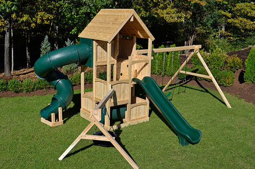 Cedar swing set with five levels, wood roof, monkey bars, tube slide and tire swing.