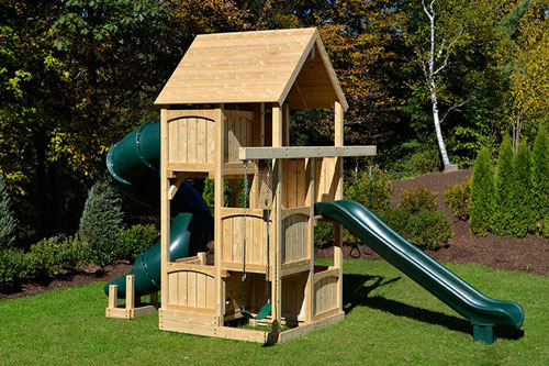 Cedar swing set with woof roof, tube slide and swings for small yards.