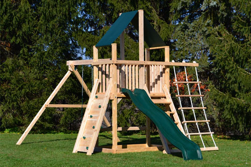 Cedar swing sets with green canopy roof, rock wall and rope ladder.