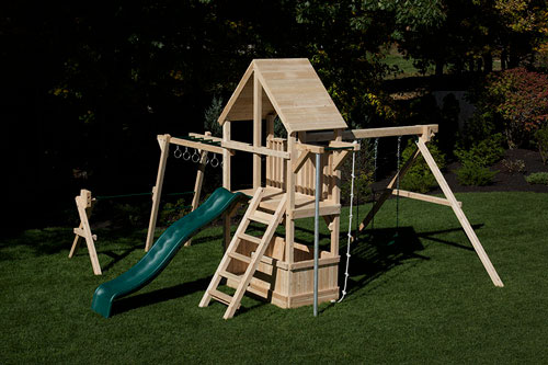 Cedar Swing set with firepole monkeybars and wood roof.