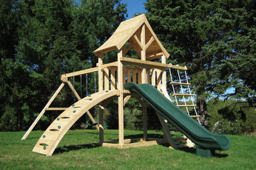 Cedar swing set with arched wood roof, rock wall and rope ladder.