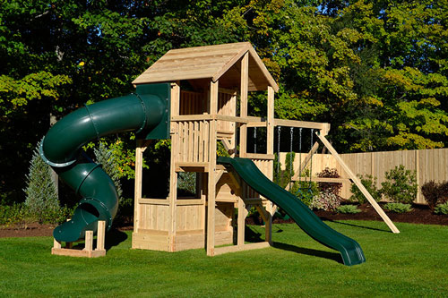 Wooden play set with four levels, tube slide and wooden roof.