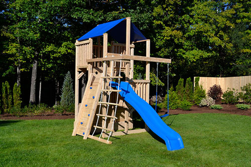 Swing set for small yards with a wooden rock wall.