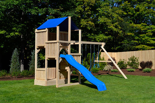 Cedar play set with four levels, wave slide, trapeze and two belt swings.