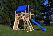 Cedar swing set for small yards with rock wall and rope ladder.
