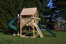 Cedar swing set for small yards with green tube slide and slide.