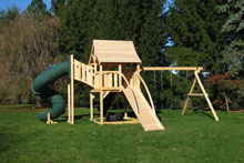 Cedar swing set with arched wood roof, tower with green tube slide and ramp.