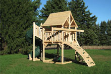 Cedar swing set for small yards with arched wood roof, rock wall and rope ladder.