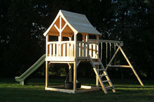 Cedar swing set with arched wood roof two swings and a green scoop slide.