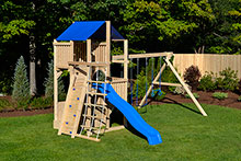 Swing set with four levels, rock wall and rope ladder.