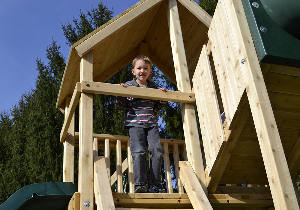 Triumph Play System's Dunmore cedar swing set with tube slide.