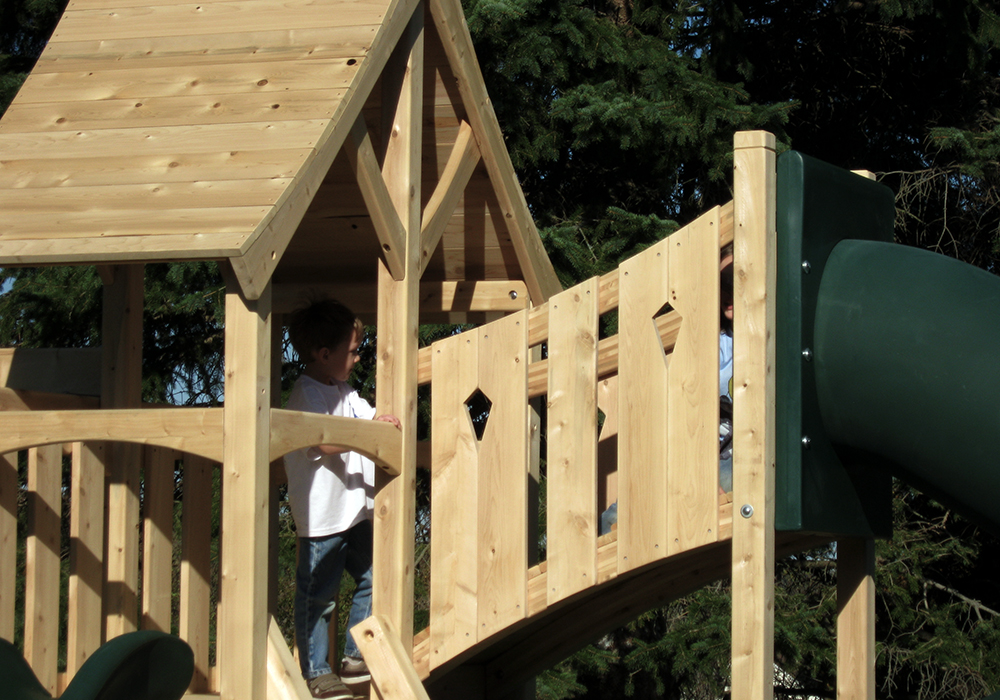 Triumph Play System's Havendale Deluxe cedar swing set with tower and tube slide.