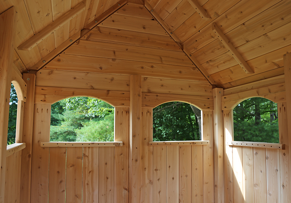 Triumph Play System's basic nottingham cedar swing set with wood roof.