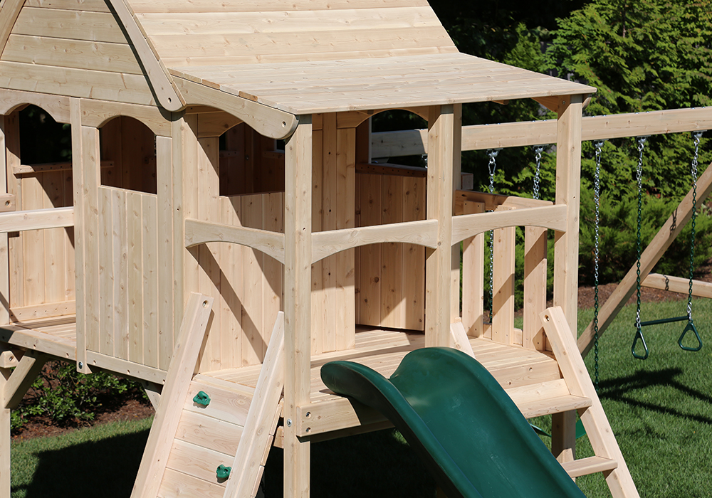 Triumph Play System's Nottingham Climber cedar swing set with wood roof.