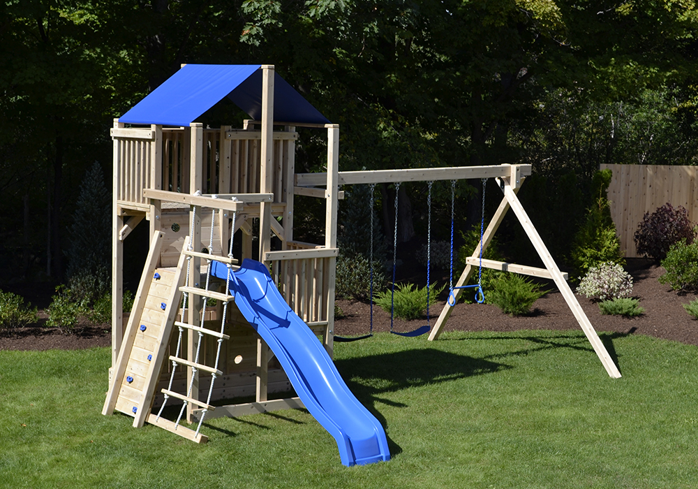 Cedar swing set with rock wall and rope ladder.
