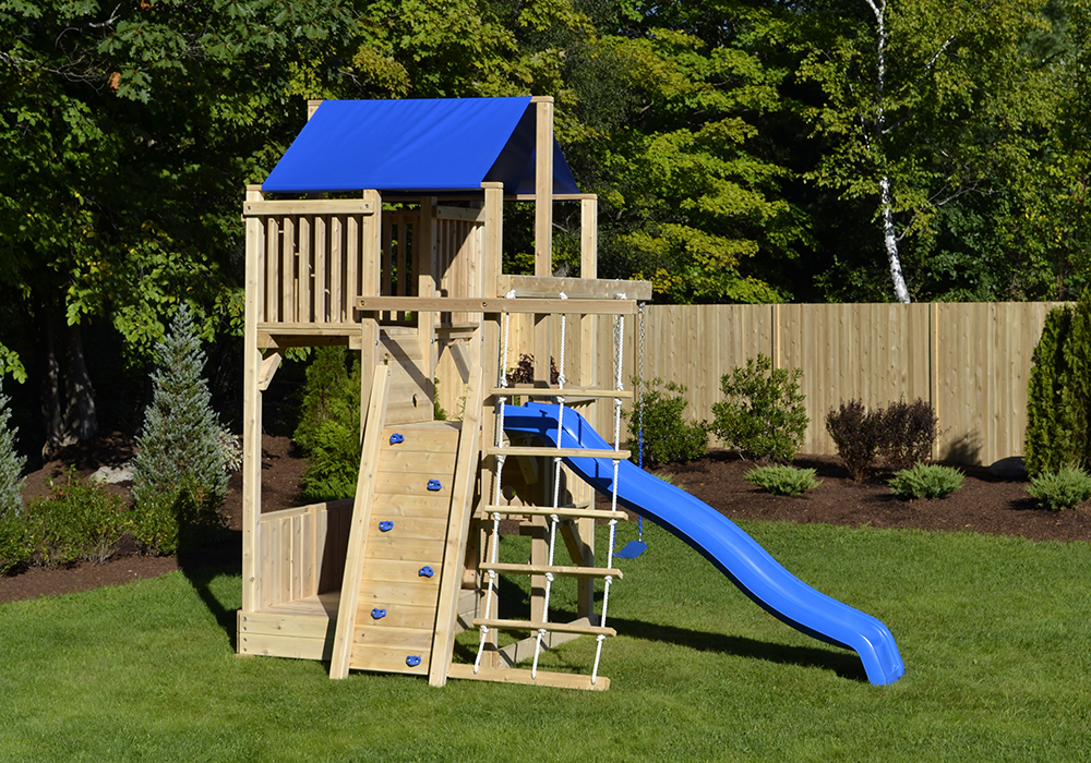 Cedar swing set with for small yards with rock wall.
